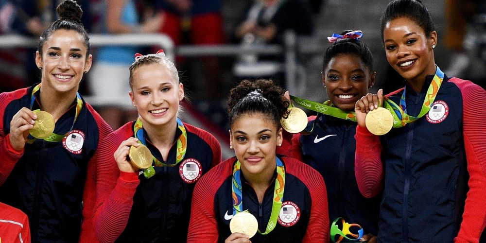 080916-sports-simone-biles-and-u-s-women-s-gymnastics-squad-win-olympic-gold