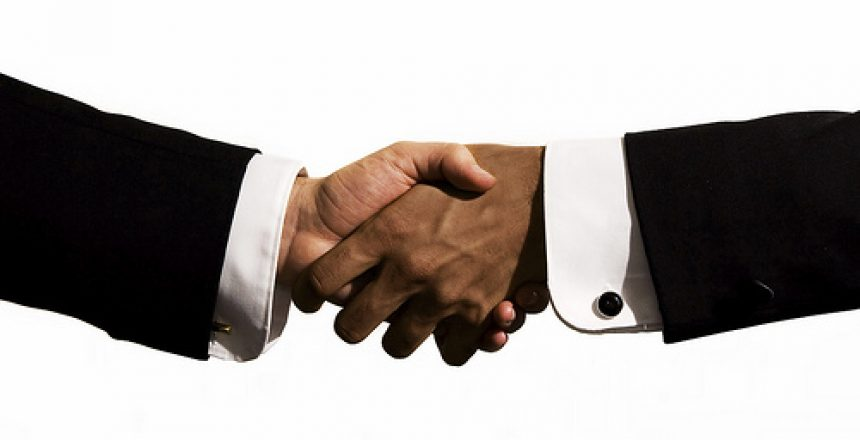 An interracial business hand shake