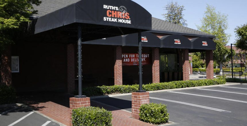 The Ruth's Chris Steak House is seen in Sacramento, Calif., Tuesday, April 21, 2020. The restaurant chain is among those businesses that qualified for the maximum $10 million in loans under the Paycheck Protection Program intended for small business affected by the coronavirus. (AP Photo/Rich Pedroncelli)