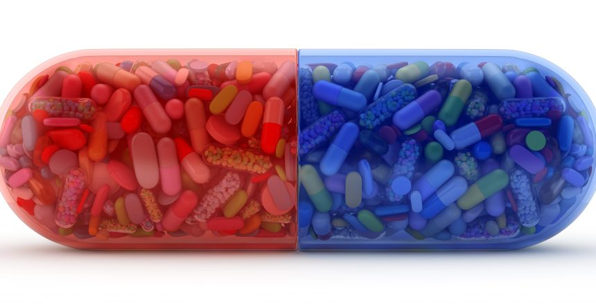 Large red and blue pill filled with colorful pills - 3d render